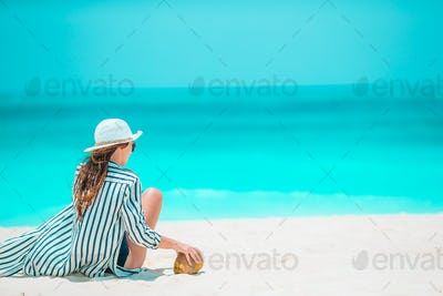 Young beautiful woman on beach vacation on Caribs
