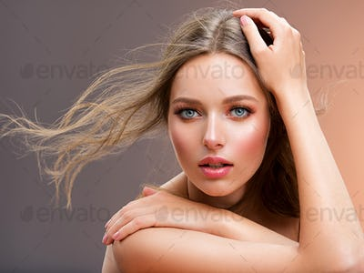 Portrait of a beautiful woman with a long hair. Model with beautiful hair