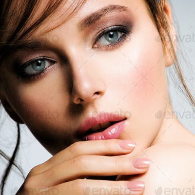 Closeup face of young beautiful woman with a healthy clean skin.