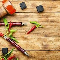 Smoking hookah with chili