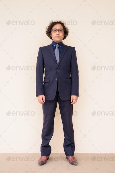 Full body shot of Japanese businessman wearing suit with eyeglasses