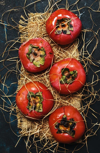 Orange Persimmons On Black Background, Rustic Style, Top View