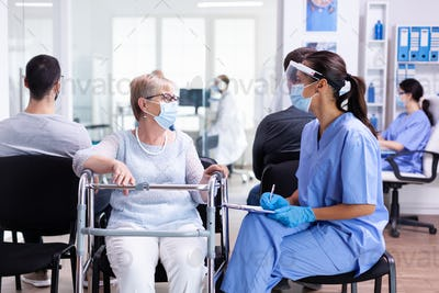 Handicapped woman discussing with medical staff