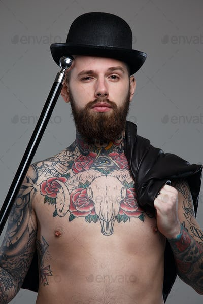 Naked tattooed male with cane