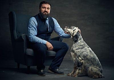A man and Irish setter dog.