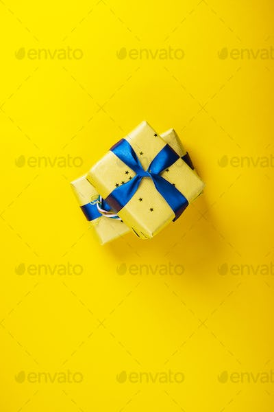 Gift boxes with blue ribbon on yellow bold color