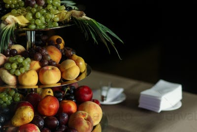 Delicious, healthy fruit tower at wedding reception dessert table