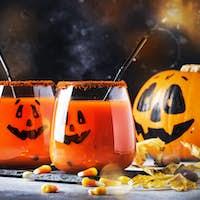 Halloween orange festive drink and pumpkin guards