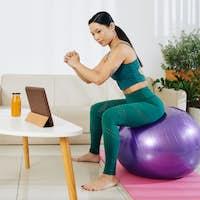 Woman training on fitness ball
