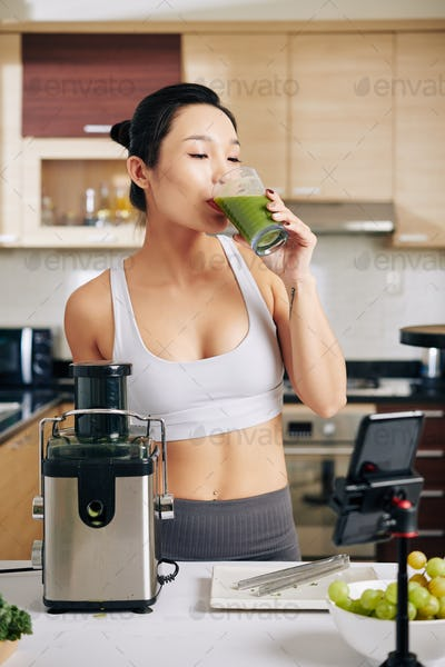 Fit woman drinking fresh juice
