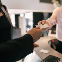 Guest makes card payment at check-in at reception.