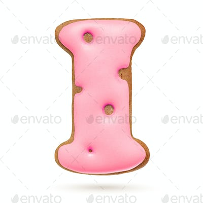 Capital letter I. Pink gingerbread biscuit isolated on white.