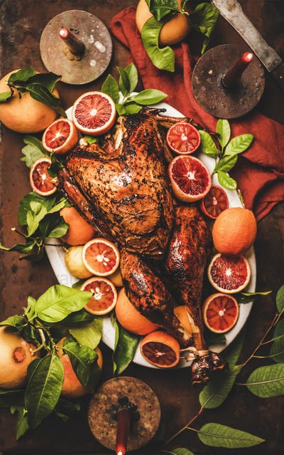 Christmas or Thanksgiving Day dinner with roasted turkey and candles
