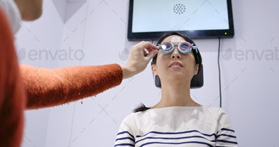 Woman visit the eye clinic undergo eye exam