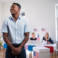 African-american man laughing in the polling place, usa elections