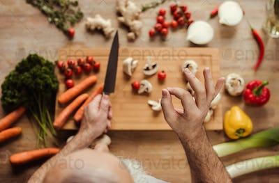 Overhead view of senior man preparing vegan food and showing ok gesture