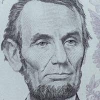 US President Abraham Lincoln face on five dollar bill macro, 5 u