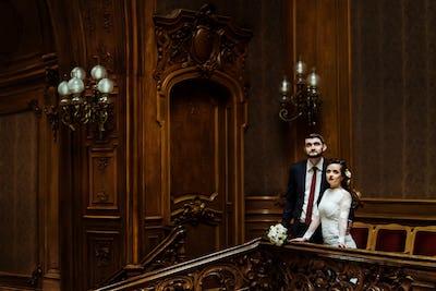 stylish luxury bride and handsome elegant groom posing