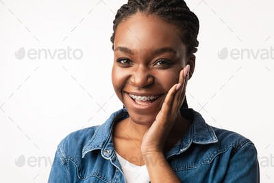 Happy African American Lady With Braces Posing On White Background