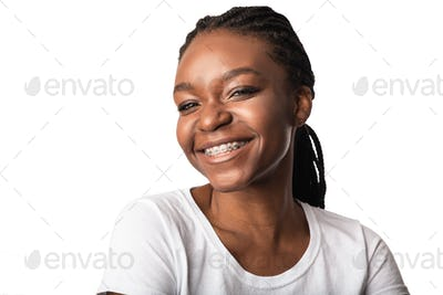 African Woman With Dental Braces Smiling Posing Over White Background