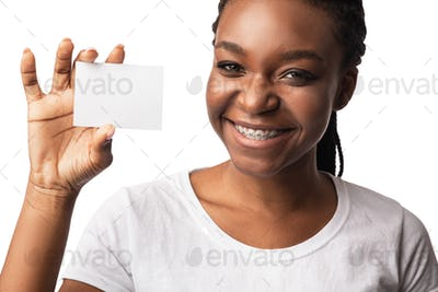 Black Woman In Braces Showing Empty Visiting Card, White Background