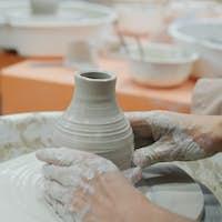 Making ceramic pot on turning pottery wheel