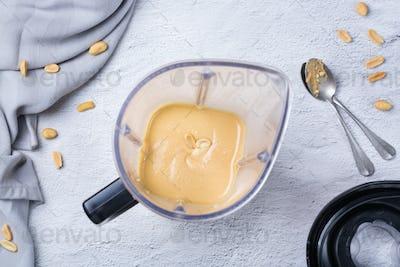Preparation homemade peanut butter in a mixer, blender