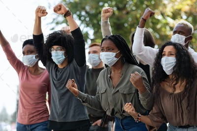 Active international students in face masks protesting against quarantine