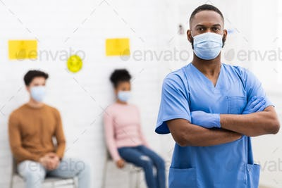 Confident African American Doctor In Medical Mask Standing In Hospital