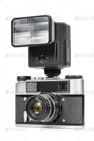 Vintage analog camera with manual flash light