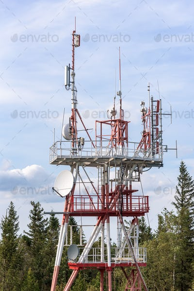 Communication tower with TV and cellular antennas