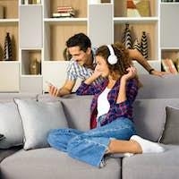 Happy young couple relaxing choosing music