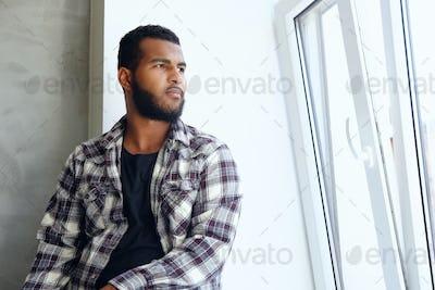 Portrait of Arabic hipster male in a fleece shirt.