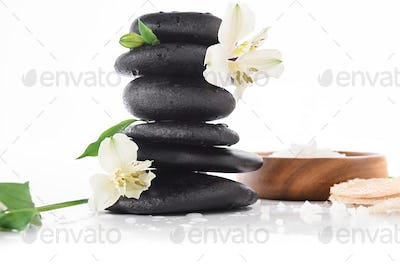 Zen stones with flowers and sea salt isolated on white, spa treatment concept