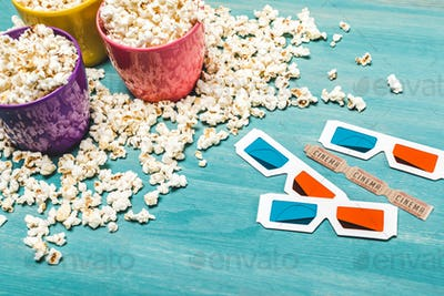 Close-up view of popcorn in bowls and 3D glasses on wooden table, Movie time concept