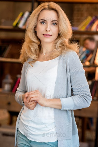 Beautiful blonde mature woman smiling and looking at camera