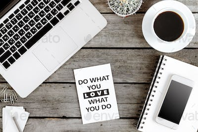 top view of Do what you love and love what you do motivational quote on modern workplace with