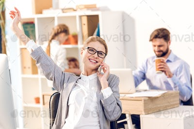 woman working in home office, happy businesswoman using smartphone with businessman and daughter