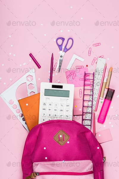 close up view of various school supplies in schoolbag