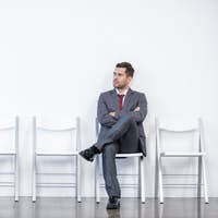 businessman sitting and waiting for interview in office, business concept