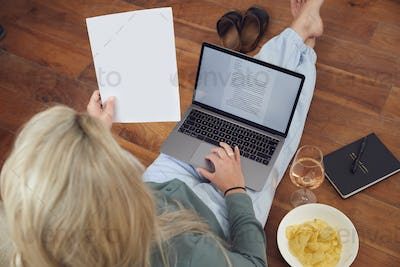 Businesswoman At End Of Day With Wine Wearing Loungewear And Suit On Laptop Working From Home