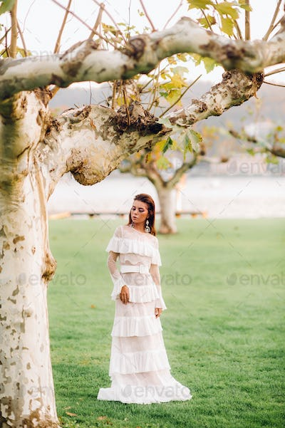 Bride in white wedding dress in the old town of Velden am w rthersee.Model in a wedding dress in