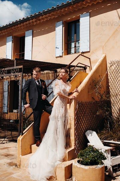 Wedding couple near a Villa in France.Wedding in Provence.Wedding photo shoot in France