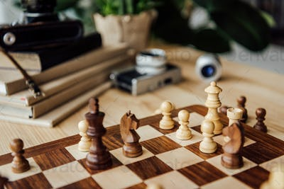 Part of chessboard with chess figures during the game at home
