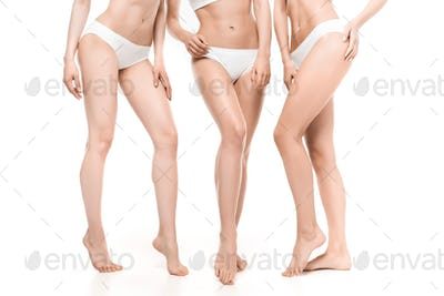 partial view of women in white underwear posing isolated on white