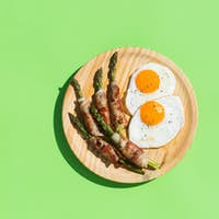 Keto, ketogenic breakfast, meal with fried eggs, bacon, asparagus