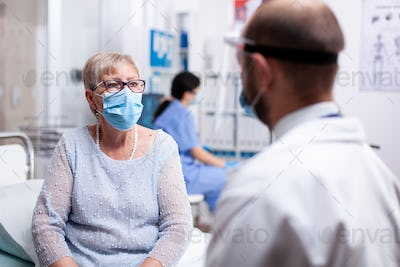Wearing protective mask during consultation