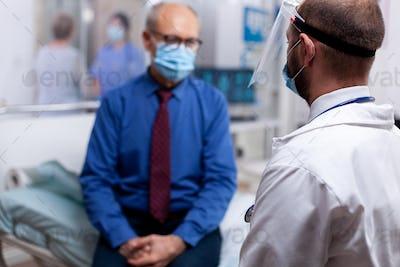 Medical practitioner using visor
