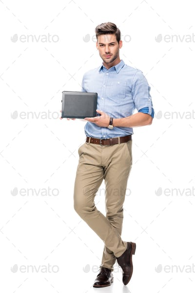 handsome young man showing digital tablet isolated on white