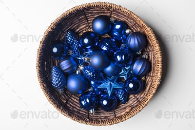 top view of blue christmas toys in basket isolated on white